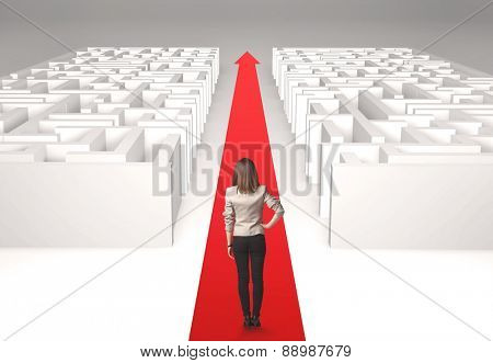 Successful businesswoman in front of a separated labyrinth, concept about simple solution