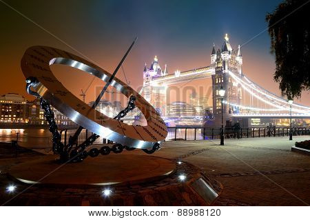 Sundial and Tower Bridge at waterfront in London