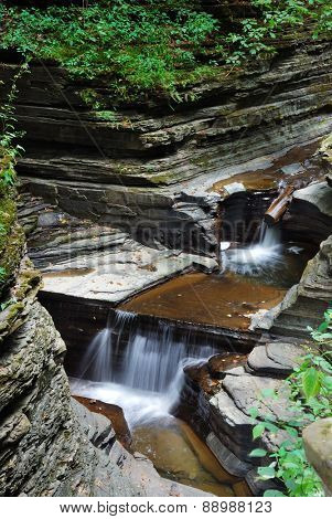 stream over rocks in woods with rocks and stream in Watkins Glen state park in New York State