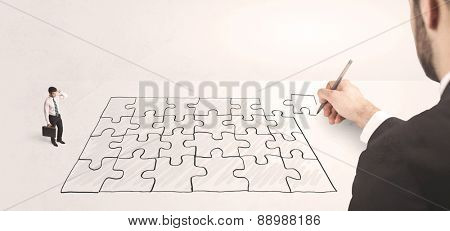Business man looking at hand drawing solution, puzzle solution concept