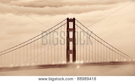 Golden Gate Bridge tower in fog closeup in San Francisco