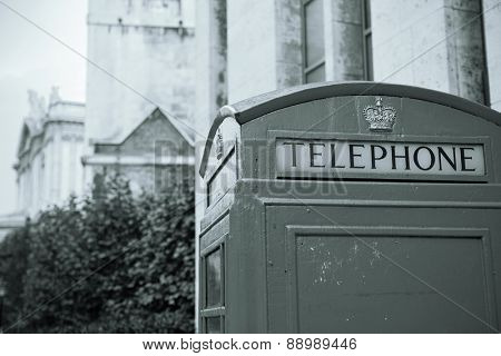 telephone booth in street with historical architecture in London.