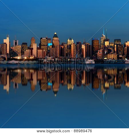Midtown Manhattan skyline with reflections at dusk panorama over Hudson River