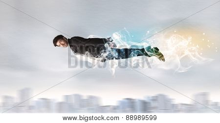 Hero superman flying above city with smoke left behind concept