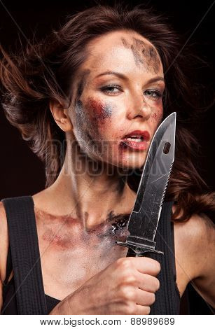 sexy woman holding a dangerous knife in her hand