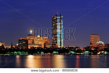 Boston Charles River at dusk with urban city skyline and light reflection