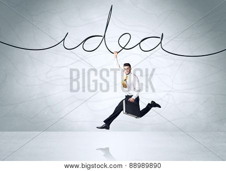 Businessman hanging on an idea rope