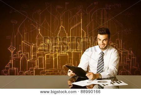 Businessman sitting at the black table with hand drawn buildings and numbers on the background