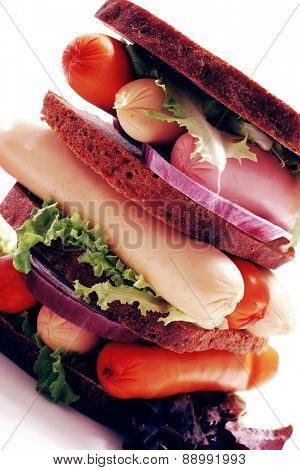 fresh beef meat sausage sandwich with green salad and tomatoes isolated on white background