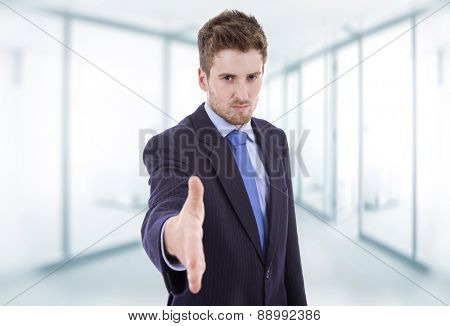businessman in suit offering to shake the hand at the office
