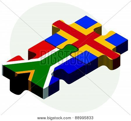 South Africa And Aaland Islands Flags In Puzzle