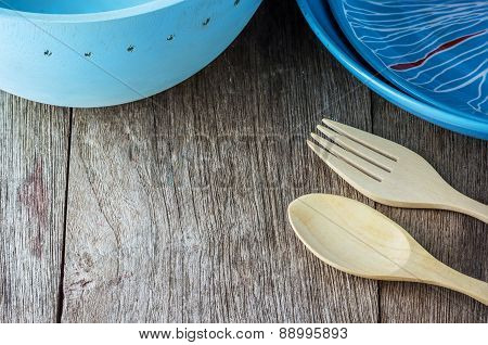 Blue Empty Plates With Fork, Spoon On Wooden Table