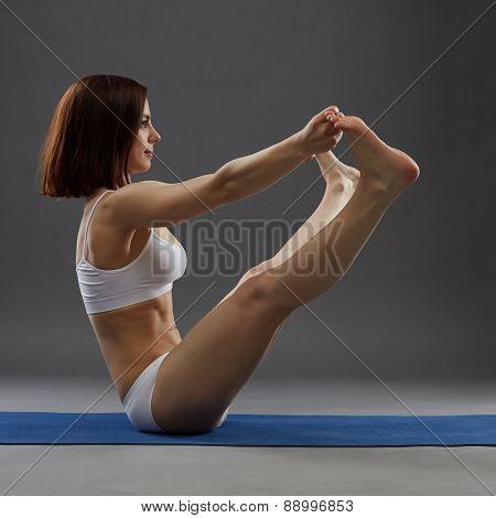 Studio shot of yoga instructor is training