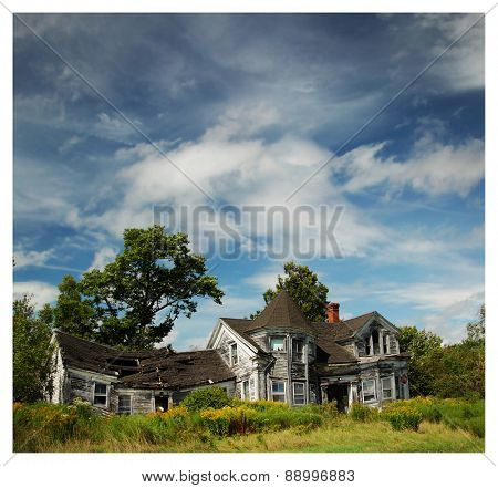 Abandoned house in a blue sky