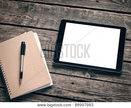 Tablet with ring binder on desktop. Clipping path included.