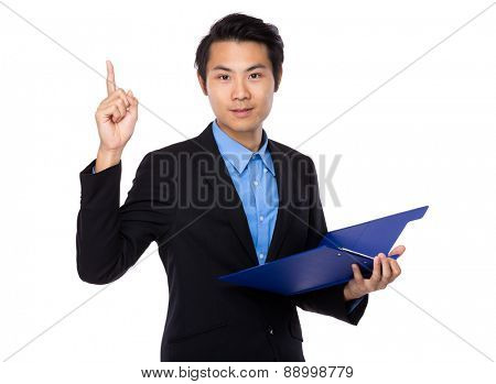 Businessman hold with clipboard and finger pointing up