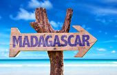 stock photo of dauphin  - Madagascar wooden sign with beach background - JPG