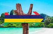 stock photo of mauritius  - Mauritius Flag wooden sign with beach background - JPG