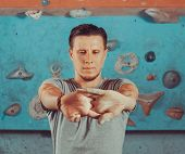 picture of climb up  - Young man warming up his hands before climbing indoor - JPG