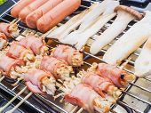 picture of grilled sausage  - Grilled bacon and mushroom rolled with sausages on electrical grilled - JPG