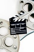 picture of mm  - Two movie reels for 35 mm film projector with clapper board and filmstrip on neutral background vertical frame - JPG