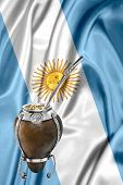 picture of gaucho  - an Argentinean mate1 over an argentinean flag - JPG