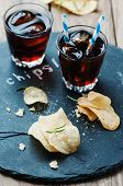 image of potato chips  - Potato chips and glass of cola on the table selective focus - JPG
