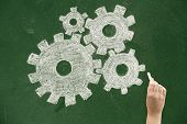 stock photo of mechanical drawing  - Drawing gears on blackboard Concepts and ideas on blackboards - JPG