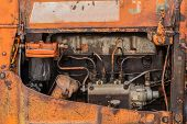 picture of cylinder  - old orange rusty four cylinders tractor engine - JPG