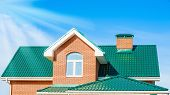 pic of chimney  - chimney on the roof of the house against the blue sky - JPG