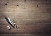 stock photo of barber  - Vintage Barber Equipment On Wood Background With Place For Text - JPG