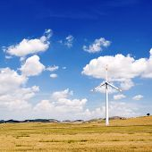 picture of generator  - wind generators turbine and blue sky with clouds  - JPG