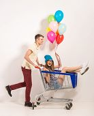 picture of trolley  - Portrait of happy young couple having fun - JPG