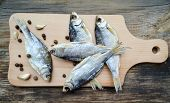 pic of cod  - Salty stockfish cod on wooden board with gaarlic and pepper - JPG