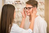 pic of optical  - Optical store client man and professional specialist help to choose - JPG