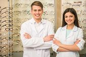 pic of optical  - Team of happy opticians optometrists standing in optical shop - JPG