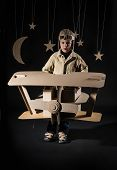 picture of boys night out  - Boy is playing with handmade toy plane - JPG