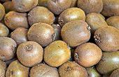 foto of stall  - organic kiwi fruit pile at market stall - JPG