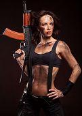 image of ak 47  - Sexy blond woman killer holding automatic gun ak 47 - JPG