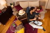 foto of leaving  - Happy young couple reviewing photos of holiday before leaving apartment - JPG