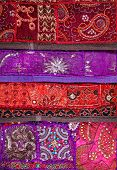 picture of flea  - Colorful ethnic Rajasthan cushion cover on flea market in India - JPG
