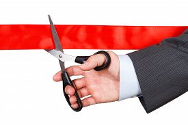 picture of pompous  - Businessman in suit cutting red ribbon with pair of scissors isolated on white background - JPG