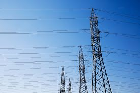 foto of electricity pylon  - Row of numerous high - JPG