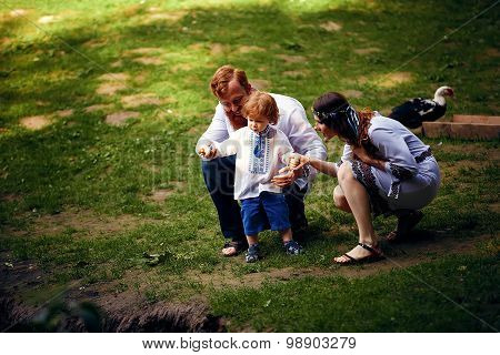 Happy family with little son in traditional ukrainian dress