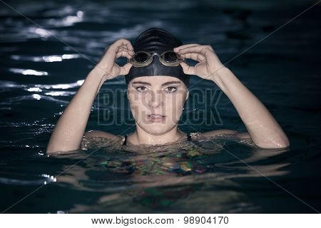 Woman Athlete In Swimming Pool Water. Sport.
