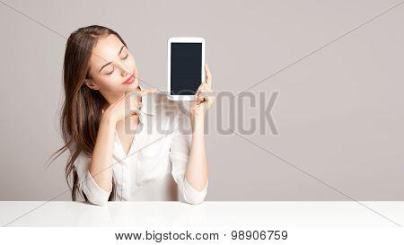Brunette Woman Using Tablet Computer.