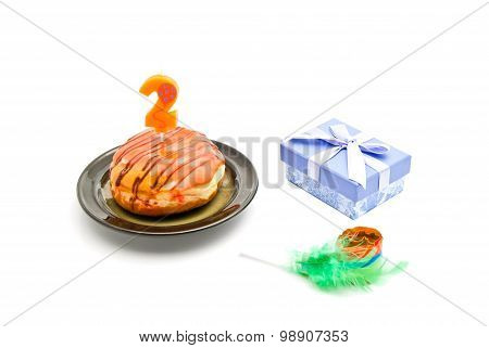 Donut With Two Years Birthday Candle, Gift And Whistle On White