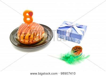 Donut With Eight Years Birthday Candle, Whistle And Gift On White