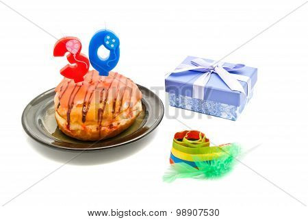 Donut With Thirty Years Birthday Candle, Whistle And Gift On White
