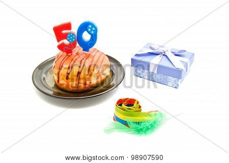 Donut With Fifty Years Birthday Candle, Whistle And Gift On White